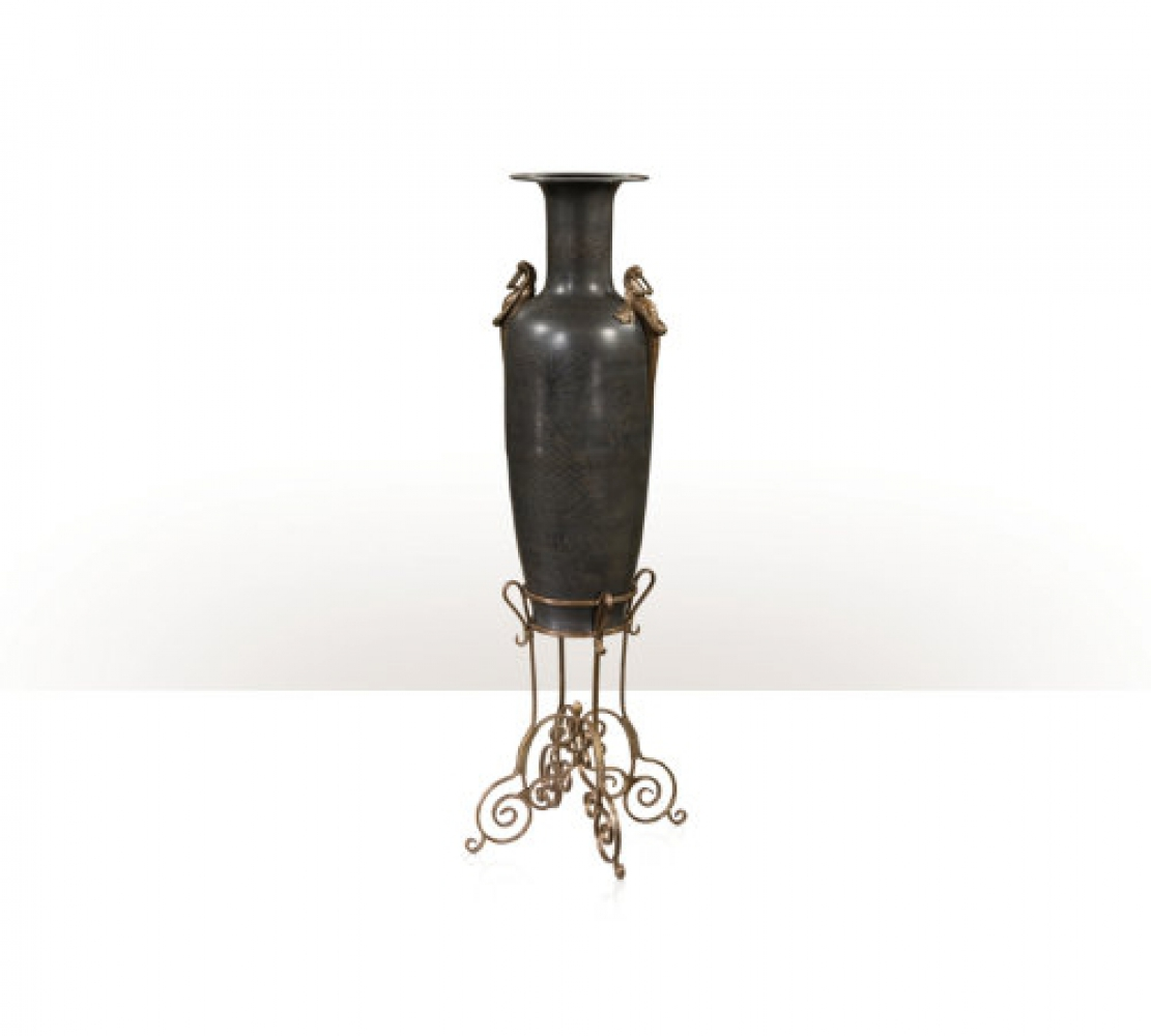 A large verdigris brass and brass engraved vase on stand