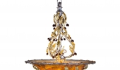 Gold chandelier in amber berry dome